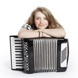 Smiling teenage girl on the floor of studio with accordion stock photos