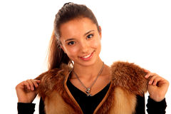 Smiling teenage girl in fur vest Royalty Free Stock Image