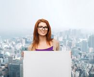 Smiling teenage girl in glasses with white board Stock Images