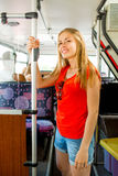 Smiling teenage girl going by bus Royalty Free Stock Photography