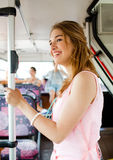Smiling teenage girl going by bus Stock Photography