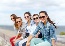 Smiling teenage girl hanging out with friends Stock Photography