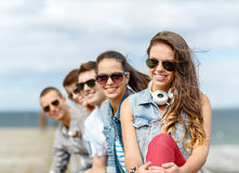 Smiling teenage girl hanging out with friends Royalty Free Stock Images