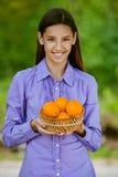 Smiling teenage girl holding basket Stock Photos
