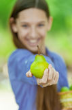 Smiling teenage girl holding basket of pears Royalty Free Stock Images