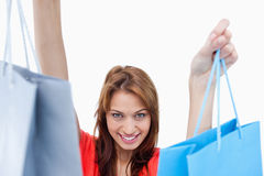 Smiling teenage girl holding shopping bags Royalty Free Stock Photography