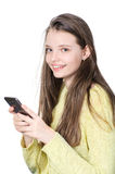 Smiling teenage girl holding smartphone in hands. Royalty Free Stock Photos