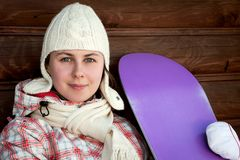 Smiling teenage girl holding snowboard Royalty Free Stock Photos