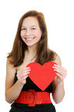 Smiling teenage girl holding valentine heart Royalty Free Stock Image