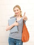 Smiling teenage girl with laptop Stock Photo