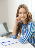 Smiling teenage girl laptop computer and notebook Stock Photography