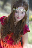 Smiling teenage girl leaning against tree royalty free stock photos