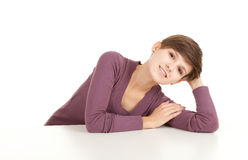 Smiling teenage girl leaning on the white table Royalty Free Stock Photo