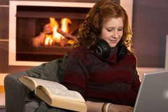 Smiling teenage girl learning at home Stock Image