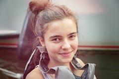 Smiling teenage girl with lifejacket. Portrait of a smiling teenage girl with lifejacket Royalty Free Stock Image