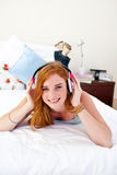 Smiling teenage girl listening to the music Stock Photography