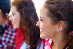 Smiling teenage girl outdoors with friends Royalty Free Stock Photo