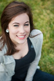 Smiling teenage girl outisde. A smiling teenage girl outside on the grass Stock Photo