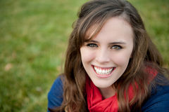 Smiling teenage girl outisde. A smiling teenage girl outside on the grass Stock Photography