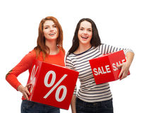 Smiling teenage girl with percent and sale sign Royalty Free Stock Photo