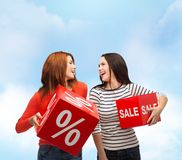 Smiling teenage girl with percent and sale sign Stock Image