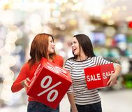 Smiling teenage girl with percent and sale sign Stock Photo