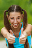 Smiling Teenage Girl Picks Up Big Royalty Free Stock Photography