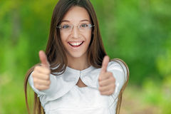 Smiling teenage girl picks up big Royalty Free Stock Images