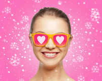 Smiling teenage girl in pink sunglasses Stock Photography