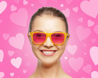 Smiling teenage girl in pink sunglasses Royalty Free Stock Image