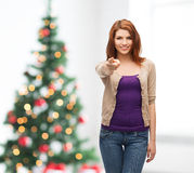 Smiling teenage girl pointing finger at you Stock Images