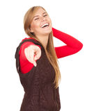 Smiling teenage girl pointing you Stock Photography