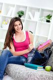 Smiling teenage girl preparing for school Royalty Free Stock Photo