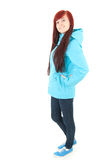 Smiling teenage girl in raincoat, full length Royalty Free Stock Image