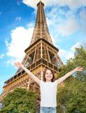 Smiling teenage girl with raised hands Stock Image