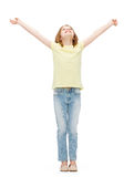Smiling teenage girl with raised hands Stock Photos
