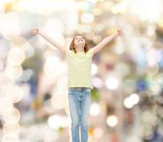 Smiling teenage girl with raised hands Stock Images