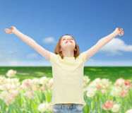 Smiling teenage girl with raised hands Royalty Free Stock Photos