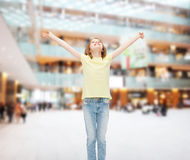Smiling teenage girl with raised hands Stock Photography