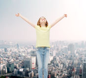 Smiling teenage girl with raised hands Royalty Free Stock Photography
