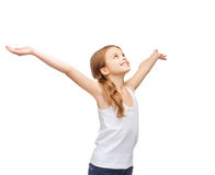 Smiling teenage girl with raised hands Stock Photo
