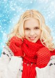 Smiling teenage girl in red mittens and scarf Royalty Free Stock Image