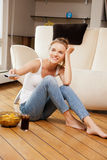 Smiling teenage girl with remote control. Picture of smiling teenage girl with remote control Stock Image