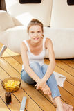 Smiling teenage girl with remote control Royalty Free Stock Image
