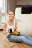 Smiling teenage girl with remote control. Picture of smiling teenage girl with remote control Royalty Free Stock Images