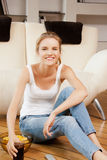 Smiling teenage girl with remote control. Picture of smiling teenage girl with remote control Royalty Free Stock Photo
