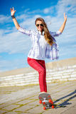 Smiling teenage girl riding skate outside Royalty Free Stock Images