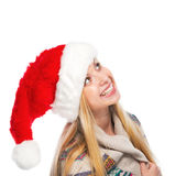 Smiling teenage girl in santa hat looking on copy space Stock Image