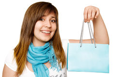 Smiling teenage girl with a shopping bag. Young smiling teenage girl with a shopping bag in his hands Royalty Free Stock Photo