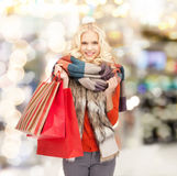 Smiling teenage girl with shopping bags Royalty Free Stock Image
